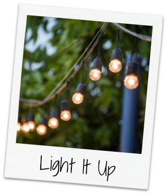 Hanging decorative christmas lights for a wedding ceremony