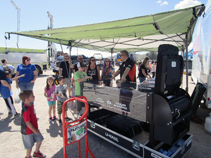 families using the trailer demonstrator at a touch a truck event