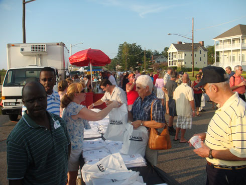 Guests gather to receive their Virginia SuperGraphic T-shirt and information kit.