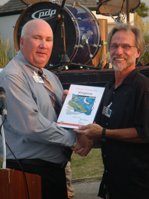 MCP Rich Cowell (Co.825) presents a plaque to David S. Powars, United States Geological Survey (USGS).
