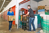 A couple loading a storage container.